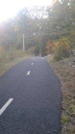 pathway winds its way thru a utility line