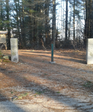 granite posts mark the entrance to Two Mile Farm in Marshfield