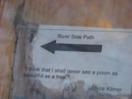 former river side path trail sign