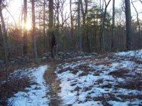 canoe club trail follows thru stone wall