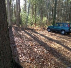 small parking lot of the hanson veterans memorial town forest