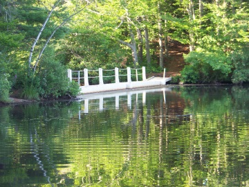 bridge leading to island in jacobs pond