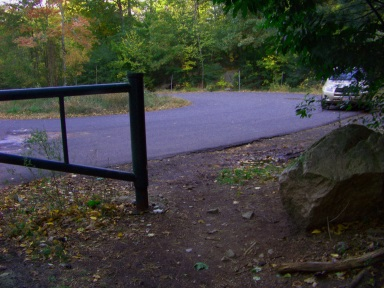Parking area at the Leavitt St entrance to Wompatuck State Park.