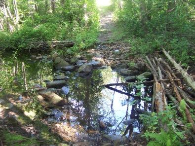trail work across water in ames nowell