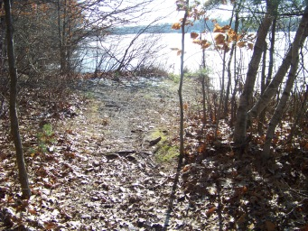 opening in trail to view of Cleveland Pond at ames nowell