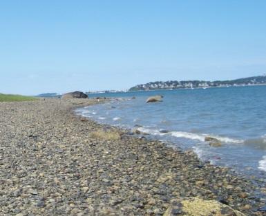 Scenic rocky shore beach on Bumpkin Island.