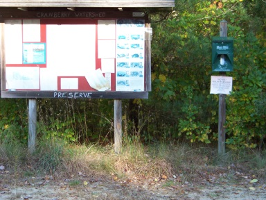 Kiosk at unused parking area at Cranberry Watershed Preserve.