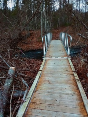 Boardwalk and bridge over Jones River at the Cranberry Watershed Preserve.