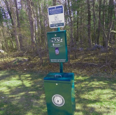 One of many doggy bag stations at Forge Pond Park in Hanover.