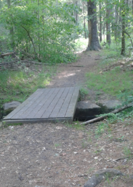 bridge into luddams ford park on indian head trail