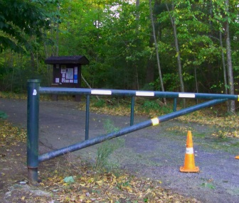 Gate and kiosk at the Leavitt St entrance to Wompatuck State Park.