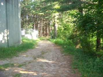 hiking trail past a water tower at myles standish monument reservation