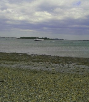 Ferry passes a stony beach at Webb Memorial State Park