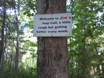 welcoming sign to jims trail in rockland