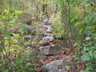 trail leading over rock wall at ames nowell state park