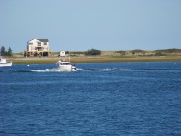 boat heading into plymouth harbor viewed from breakwater