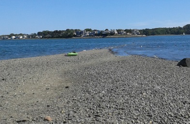 kayak pulled up on the beach at bumpkin island