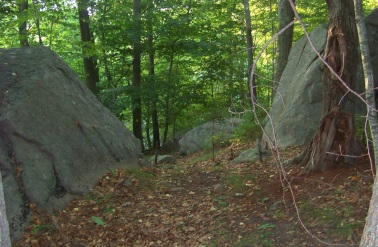 The hiking trail loop passes through these two boulders at George Ingram Park.