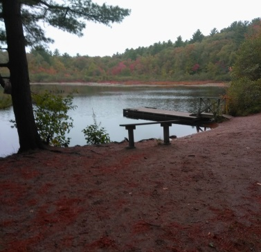 Picturesque Holly Pond in the fall at Wompatuck State Park.
