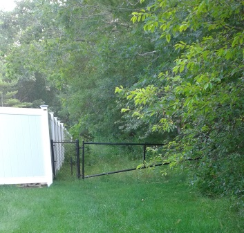 A gated entrance to an easement leading to misty meadow conservation