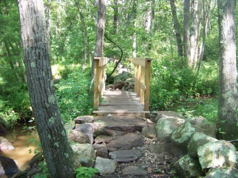 stone work leading up to a bridge crossing French stream in Rockland Town Forest