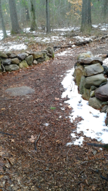 low rock wall heralds the end entrance to Jim's trail in Rockland town forest
